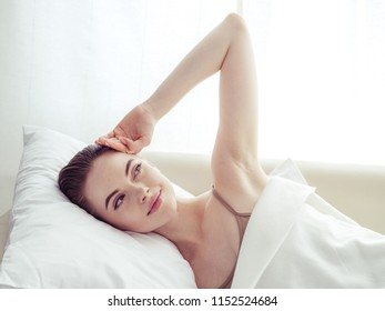 Woman in bedroom relax happy alone lifestyle