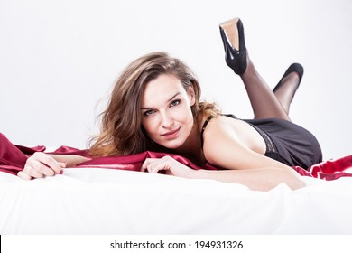 Woman in bedroom waiting for her lover
