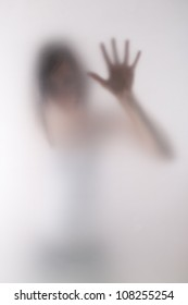 woman behind blurry glass