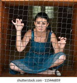 woman behind the fence