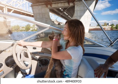 Woman behind the wheel yacht, enjoying nature and river landscape, active sailor girl, female driving luxury water transport, summertime concept