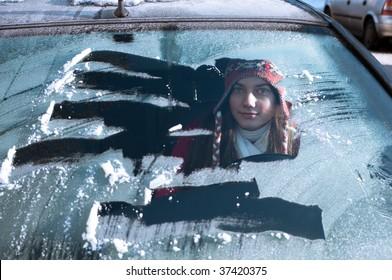 woman behind windshield in winter