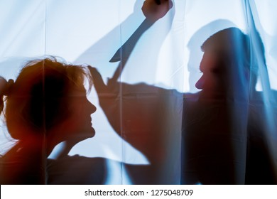 a woman is being attacked by a man with a knife