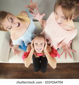 Woman being bullied by her two female friends. Women having argument. Angry fury girls screaming at her friend or younger sister. Friendship difficulties, rivaly and envy problems.