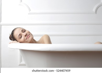 Woman being relaxed in a bathtub
