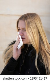 woman being sick in winter