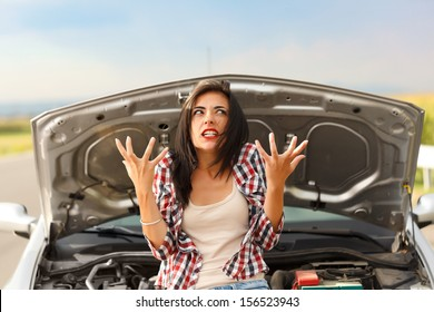 Woman being very angry because of her car's failed engine