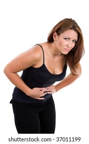 Woman bends over with stomach cramps.