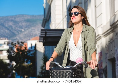 Woman with bicycle in the city