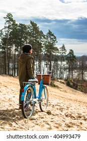 A woman with a bicycle on a city tour. Bicycle trip to the forest