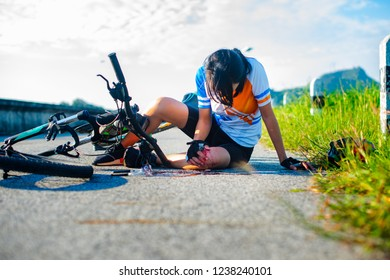 woman bicycling in hurt and injuried of leg after accident clashed, with wound and bleeding of blood flow on the surface of street road