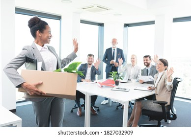 Woman bids goodbye to her colleagues