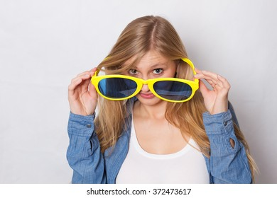 Woman in big blue yellow glasses