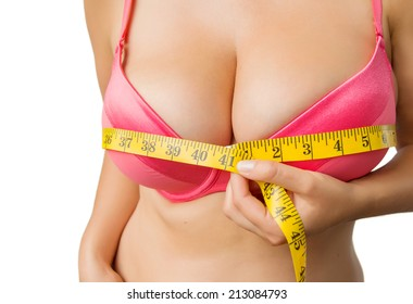 Woman with big boobs measuring her bust