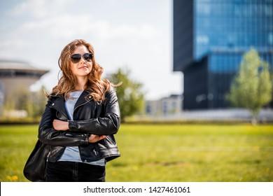Woman in big modern city walking on the street