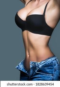 Woman big natural sexy boobs in lingerie. Plastic surger. Beautiful woman body, sexy belly, abdomen. Sexy female boob in black bra. Sexy boob.