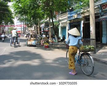 Woman with a bike in Saigon, Vietnam