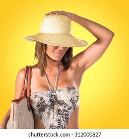 Woman in bikini over colorful background