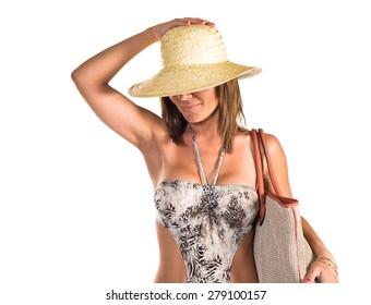 Woman in bikini over white