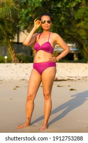 Woman in bikini stand relax at beach Koh Chang Thailand.