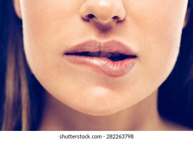 Gorgeous girl biting lip