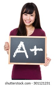 Woman with black board and showing mark A plus