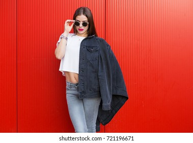 Woman with black denim jacket standing on the street