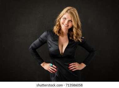 Woman in black dress with her hands on hips