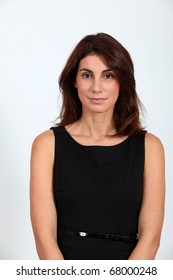 Woman in black dress looking at camera