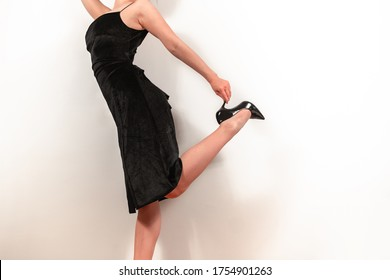 Woman in a black dress and shoes