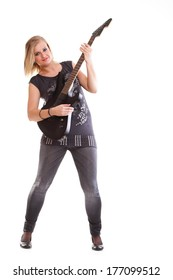 Woman with black guitar looking at you isolated on white