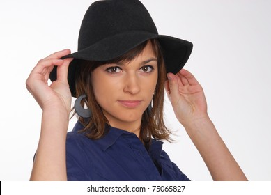 woman in the black hat