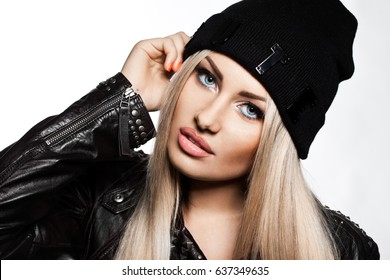woman in black hat and jacket