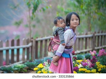 Woman from Black Hmong Hill Tribe, children girl smile,Thailand