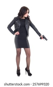 woman in black holding gun isolated on white background