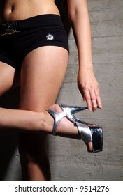 woman in black hot pant and silver stiletto