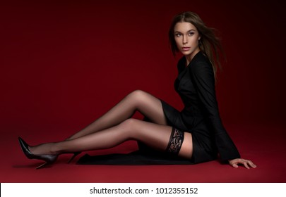 Woman in black jacket and stockings