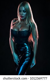 Woman in black latex skirt and lingerie