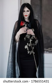 Woman in black long dress, gothic style, classical lady gothic, victorian style. Halloween dress