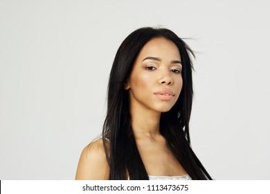 woman black looks at camera portrait