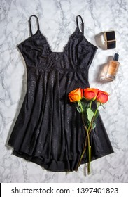 Woman black nightgown with roses, perfume and jewelry - Image