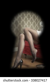 Woman in black pantyhose and high heels seen through a key hole