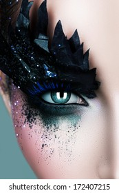 woman with black paper zigzag make-up