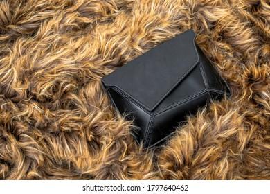 Woman Black Purse Far Fabric Background