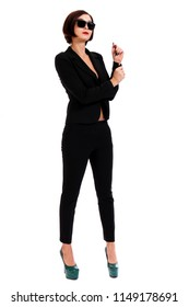Woman in a black suit isolated over white background
