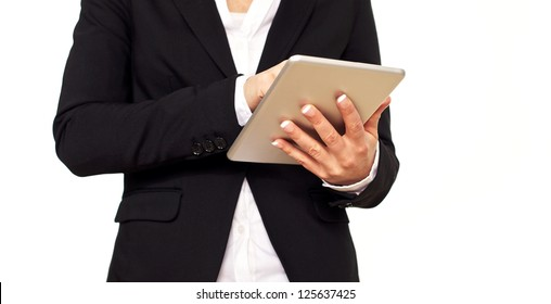 Woman in black suit using a digital tablet.