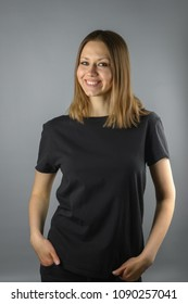 Woman in black T-shirt with empty space for text or picture