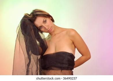 woman with black veil studio shot