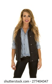 A woman with black vest stand look with smile