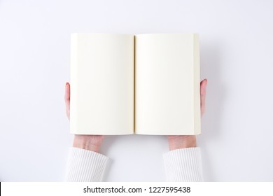 A woman with a blank book